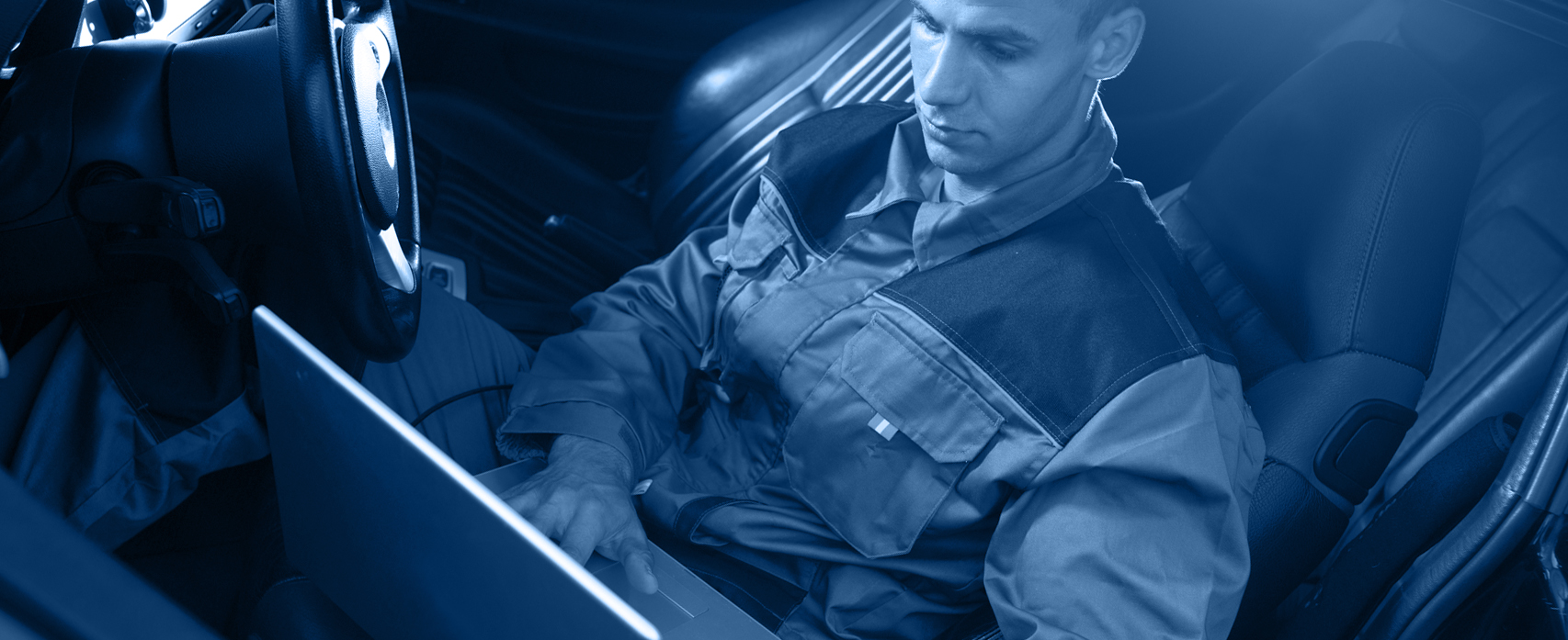 Mechanic checking a vehicle - Tuning & Remapping Dartford
